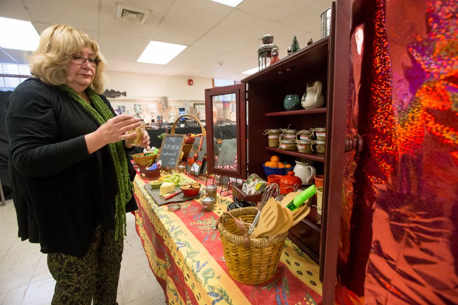 Elizabeth Sullivan of the Kitchen Cupboard sets her display up Sunday during the Artspace Marketplace at Artspace in Cheshire. November 18, 2018 | Justin Weekes / Special to the Record-Journal