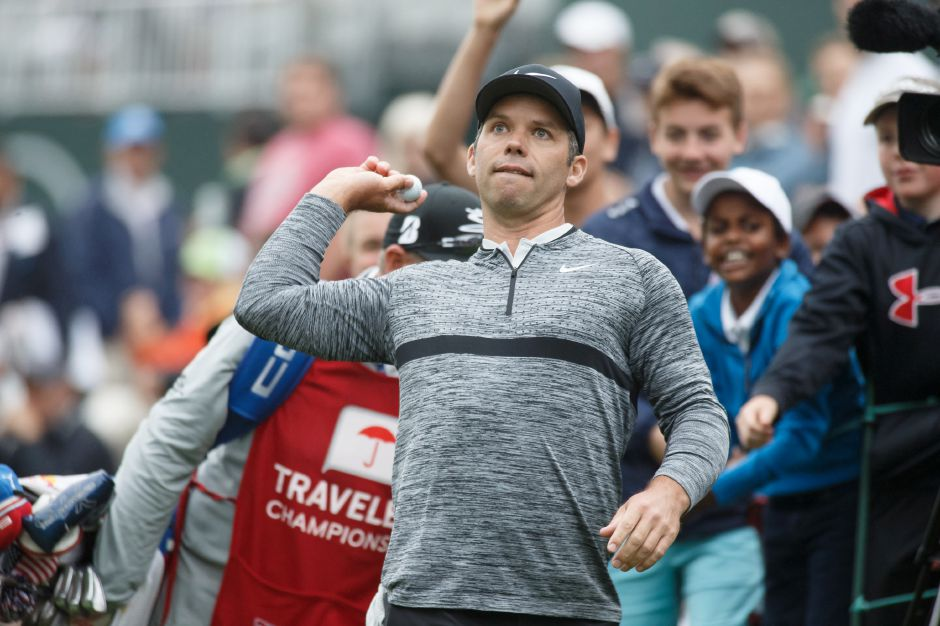 Paul Casey tossed a golf ball to fans along the 18th green after shooting a round-best 62 on Saturday, June 23, 2018, and taking a four-stroke lead into the final round of the 2018 Travelers Championship. Casey, however, let that lead get away the next day to a hard-charging Bubba Watson.