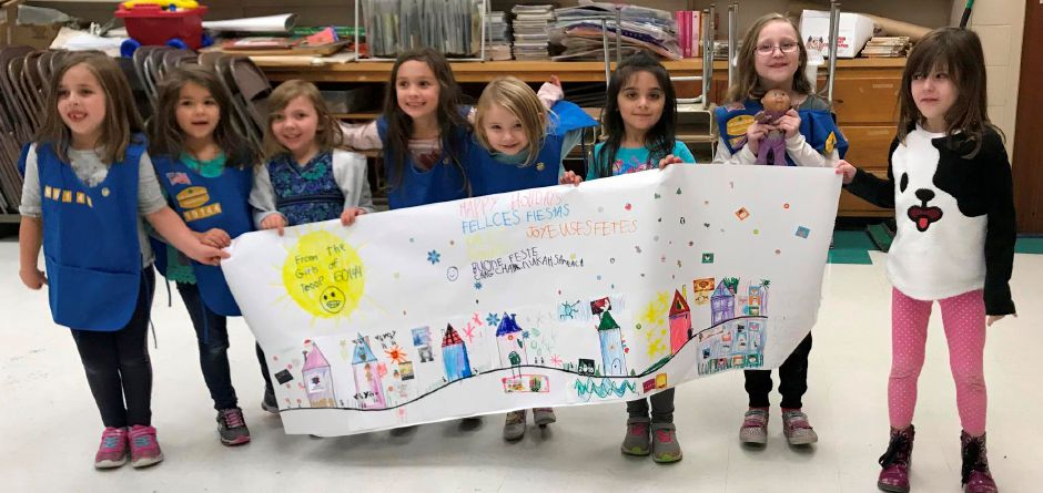 Members of the Clintonville and Montowese Daisy Scout Troop 60144 made this holiday sign that will be on display at the Town Hall for the month of December. The scouts are learning about the different holidays.