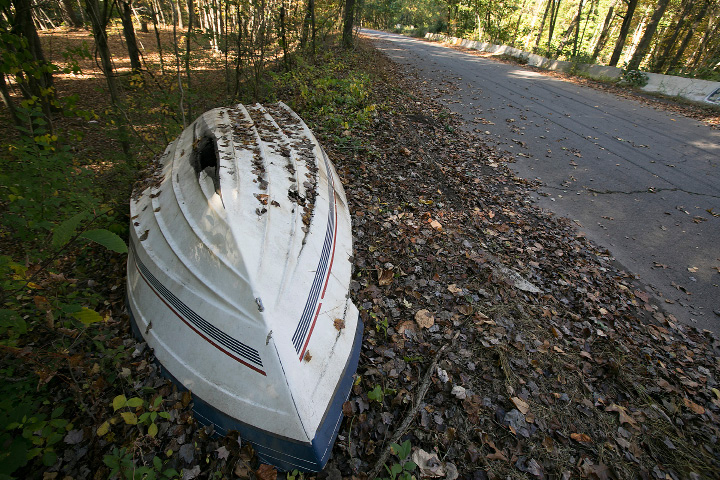 A boat discarded along Valley Service Road in North Haven, Thursday, October 12, 2017. The town plans to extend Valley Service Road to the Amazon site. | Dave Zajac, Record-Journal