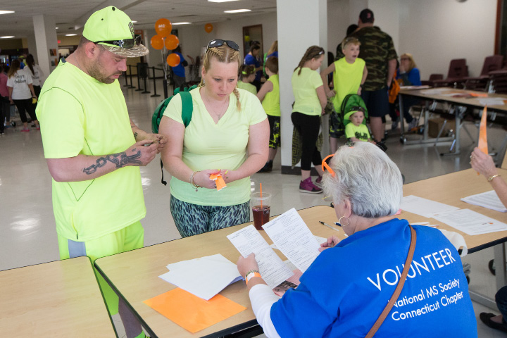 Brian and Narissa Leone of Milford register with Kathy Heun Sunday during the Walk MS held at Cheshire High School in Cheshire Apr. 17, 2016 | Justin Weekes / For the Record-Journal