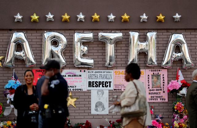 People gather outside New Bethel Baptist Church before a viewing for Aretha Franklin on Thursday in Detroit. Franklin died Aug. 16 of pancreatic cancer at the age of 76.