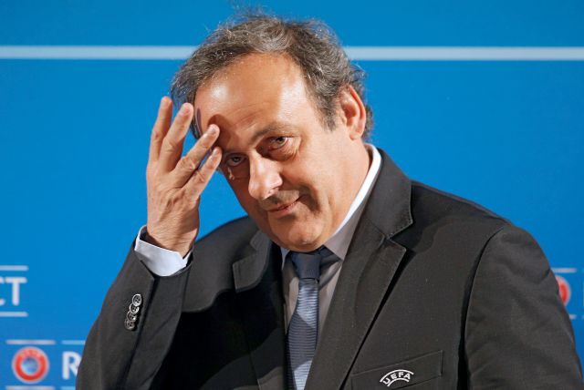 FILE - In this Feb.22, 2014 file photo, UEFA President Michel Platini arrives at a press conference, one day prior to the UEFA EURO 2016 qualifying draw in Nice, southeastern France. Former UEFA president Michel Platini has been arrested Tuesday June 18, 2019 over the awarding of the 2022 World Cup. (AP Photo/Lionel Cironneau, File)