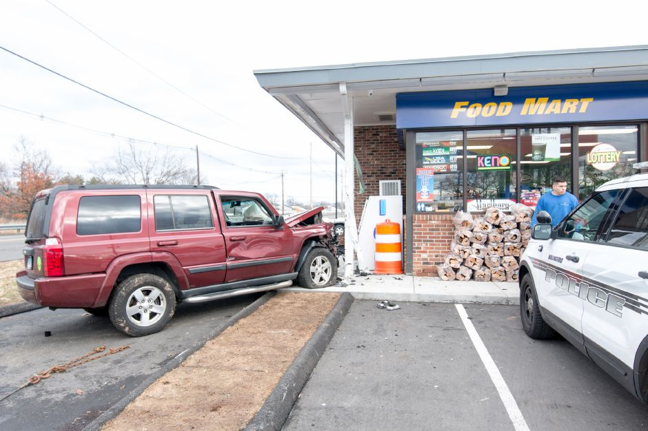 Police responded to a report of a car striking the Sunoco gas station on South Colony Road in Wallingford on Wednesday moring. | Devin Leith-Yessian/Record-Journal