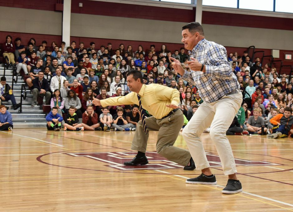 "North Haven Middle School teachers Rich DiPalma, left, and Mike Annino  try ""Fortnite"" dances during a preview assembly for the Harlem Wizards Oct. 6, 2018 game in town. The middle school's two gym floors will be replaced this summer. Bailey Wright, The Citizen"