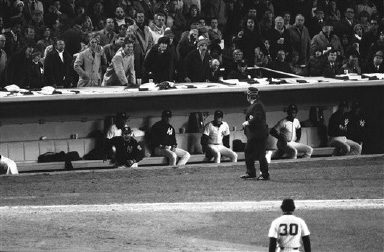 Billy Martin, left spunky manager of the New York Yankees, comes to the edge of the dugout to challenge first base umpire Bruce Froemming of the National League, Oct. 21, 1976 in New York. Martin was thrown out of the game in the ninth inning when he threw back onto the field a ball Froemming had tossed into the Yankee dugout. (AP Photo)