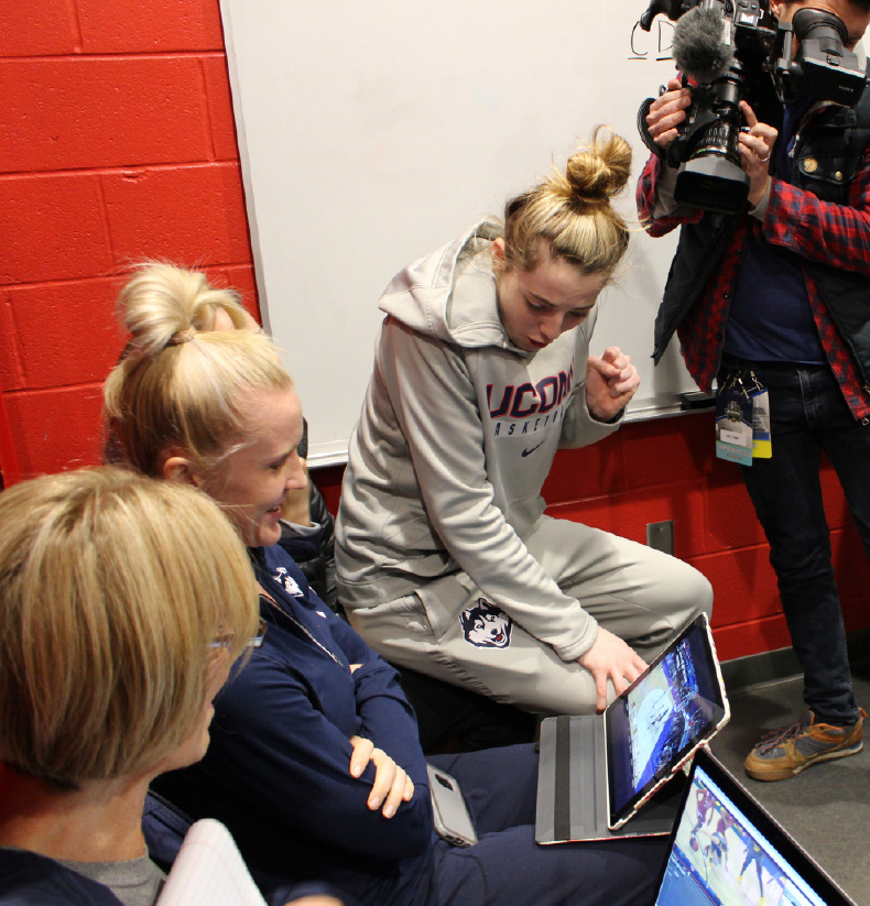 Connecticut guard Katie Lou Samuelson watches a computer in the team