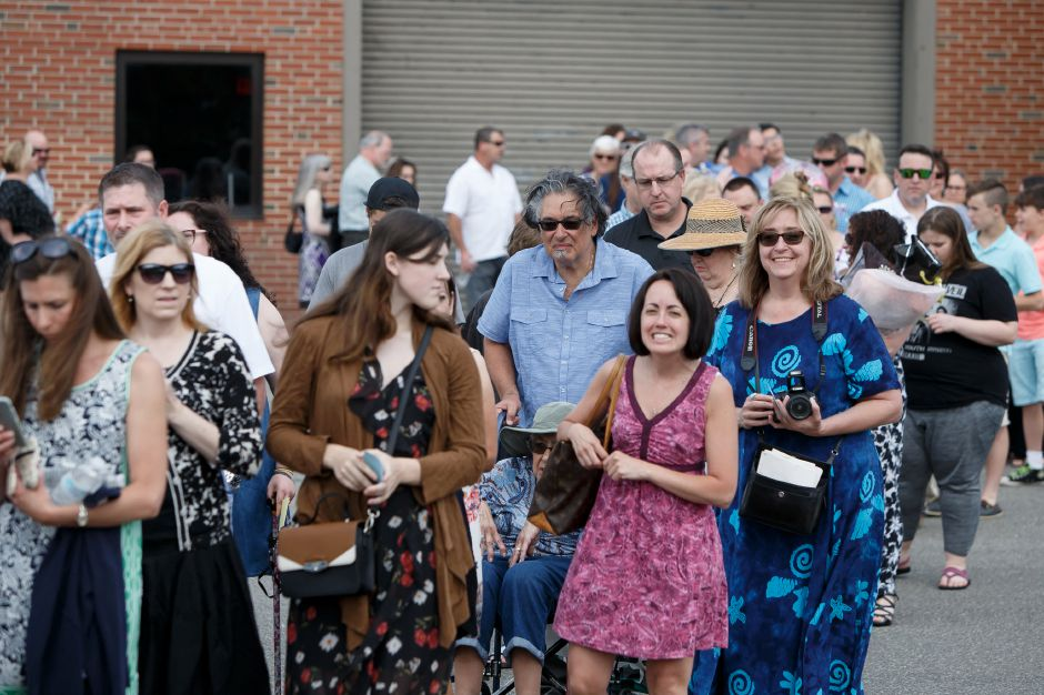Parents and families wait in line to enter the ceremony Friday during Lyman Hall High School