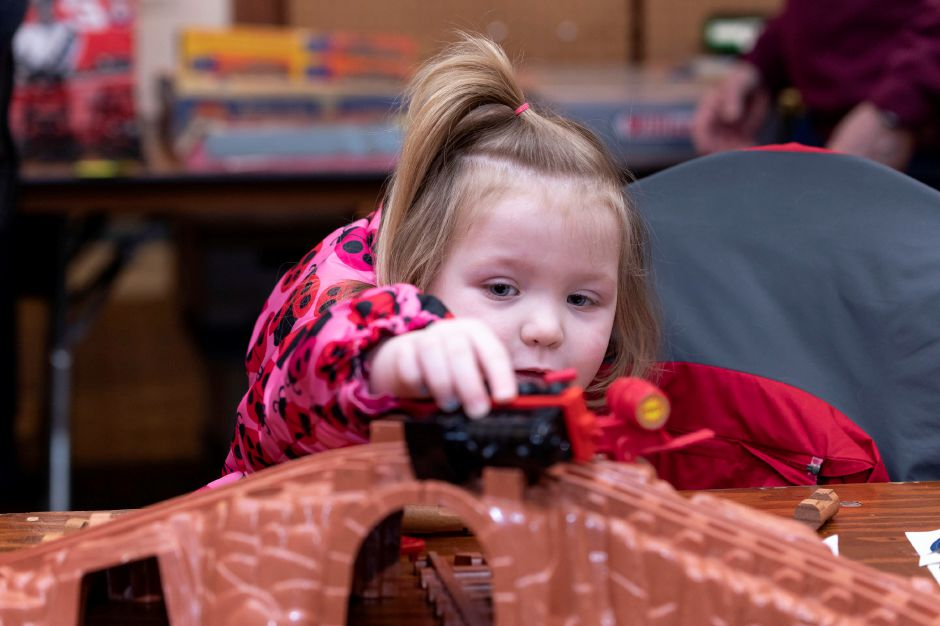 Addison Sorg, 2, plays with a toy train at the Classic Shows Model Railroad show at Zandri