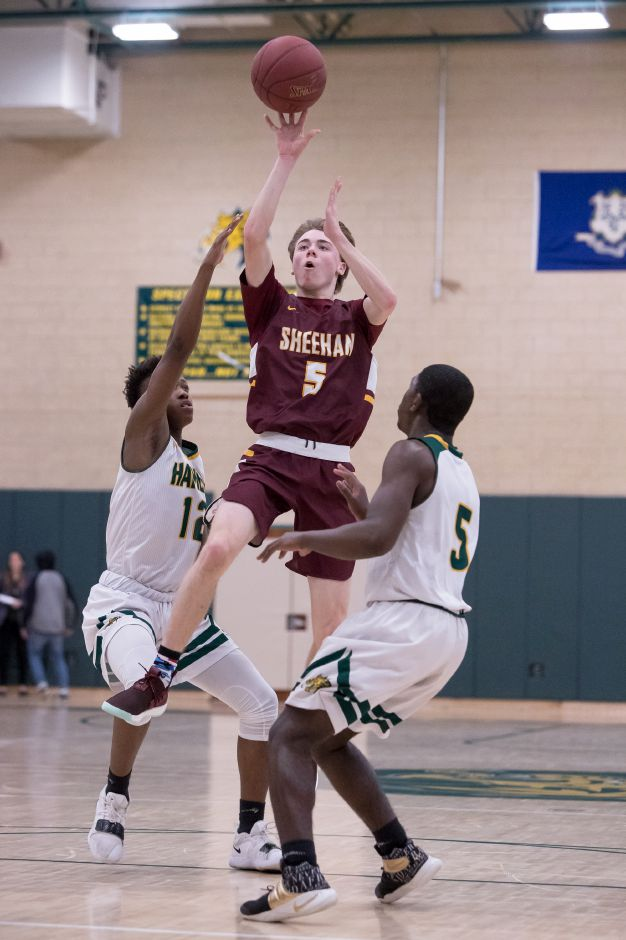 Sheehan's Caden Cloutier puts up a running shot in the lane.