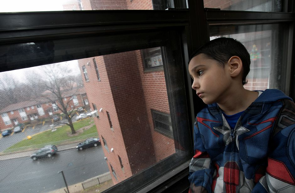 Jeremiah Negron, 6, looks out the window of his residence at the Mills Memorial Apartment complex in downtown Meriden, Thursday, April 6, 2017. The complex has been slated for redevelopment into a mixed-use development in the downtown Transit-Oriented District. Jeremiah