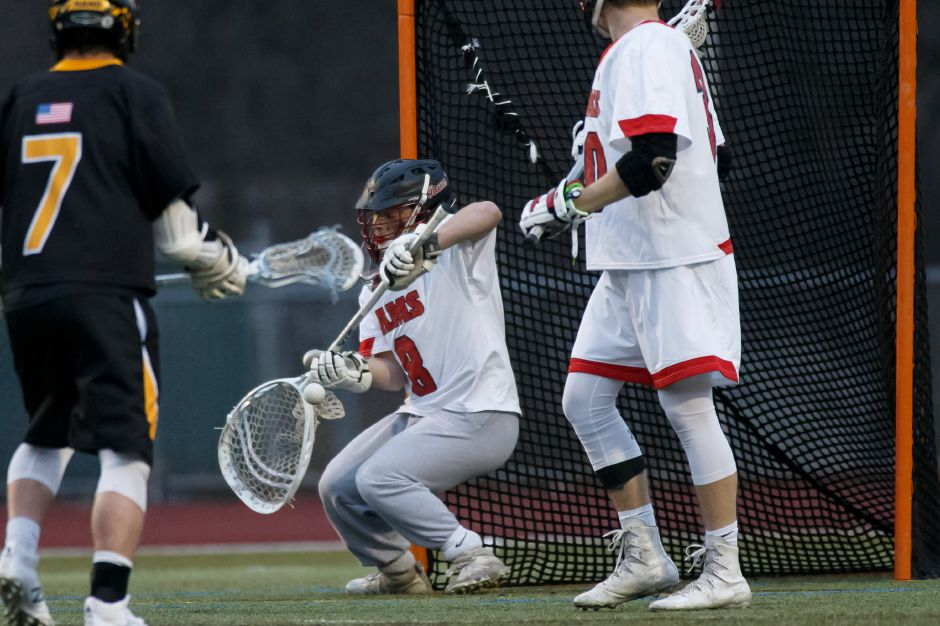Cheshire goalie Brendan Grove stops a shot by Daniel Hand on Monday night at Alumni Field. Grove, only a sophomore, has stepped into the role vacated by three-year starter and All-SCC goalie Peter Brown, who is now at Merrimack College. | Justin Weekes / Special to the Record-Journal