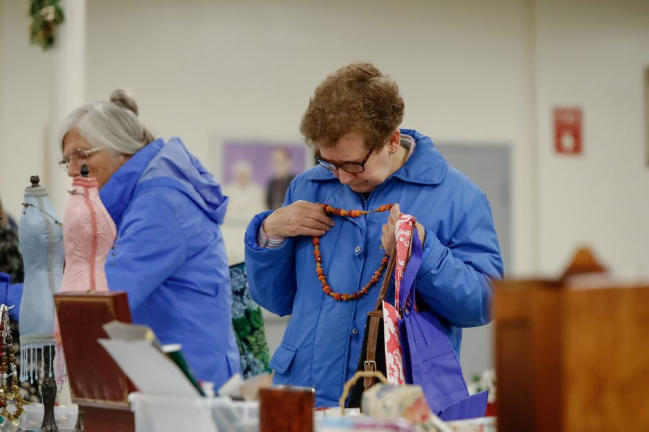 Barbara Reynolds of Hamden picks out a necklace Saturday during the Trinity Ladies Holiday Fair at the Most Holy Trinity Church in Wallingford November 3, 2018 | Justin Weekes / Special to the Record-Journal