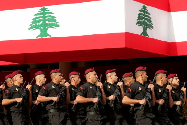 Lebanese marine special forces soldiers march during a military parade to mark the 76th anniversary of Lebanon