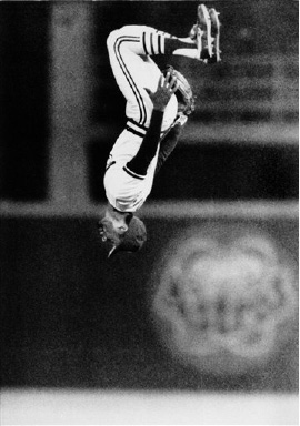 St. Louis Cardinals shortstop Ozzie Smith does a flip as he reports to his position before Game 3 of the World Series between the Cardinals and the Kansas City Royals at Busch Stadium in St. Louis, Tuesday night, Oct. 22, 1985. (AP Photo)