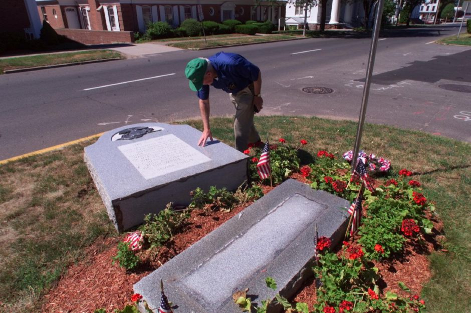 John Reardon,Sr. inspects a war monument on Broad Street that was knocked over some time during 4th of July weekend, July 7, 1999. Readon is a World War II Air Force veteran.