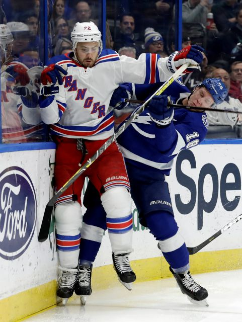 New York Rangers defenseman Kevin Shattenkirk (22) fights off a check by Tampa Bay Lightning left wing Ondrej Palat (18) during the second period of an NHL hockey game Monday, Dec. 10, 2018, in Tampa, Fla. (AP Photo/Chris O