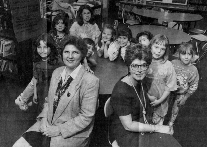 Principal Patricia Crowley, left, and teacher Sandra Skitgis sit with the school's Brownie Troop in 1995. The Wallingford school board's operations committee voted to name the Parker Farms School library after Crowley.| File photo, Record-Journal