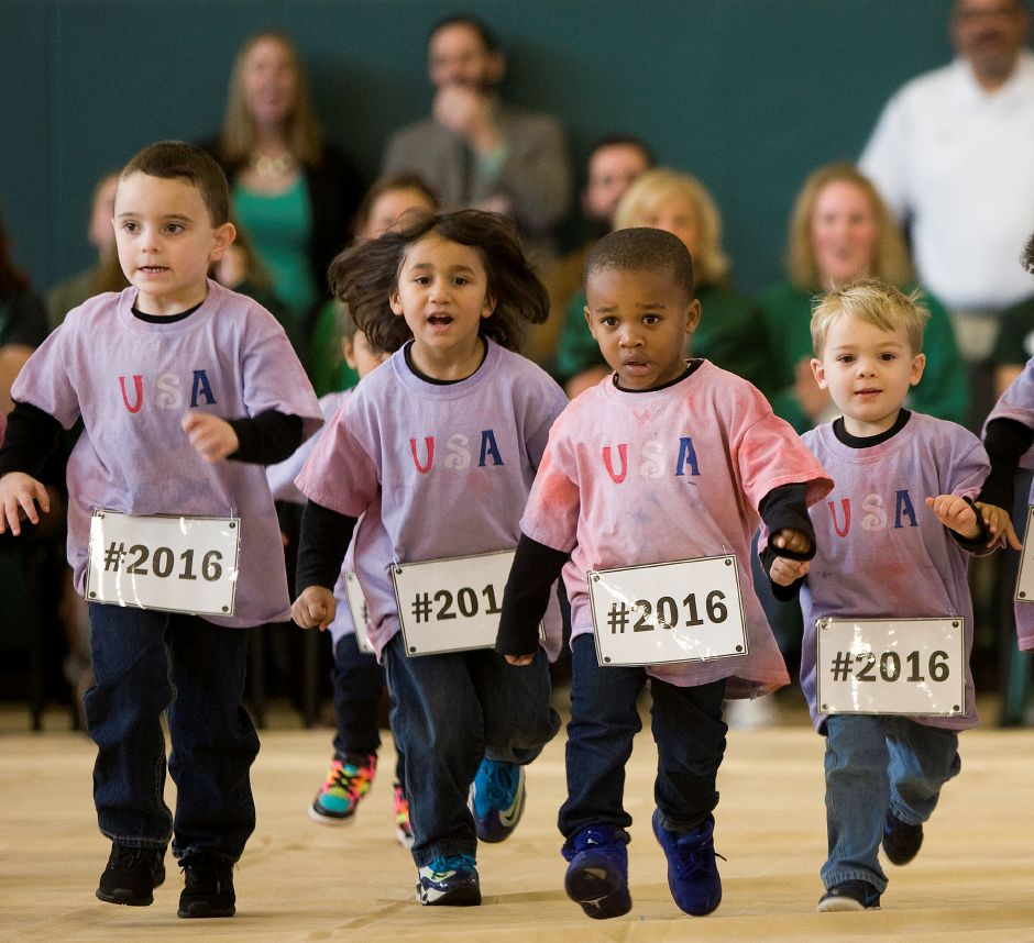 The Little Spartans help raise the roof with a race across center court during the annual pep rally at Maloney High School, Wednesday, November 23, 2016. The Little Spartans is a preschool program at Maloney High School. | Dave Zajac, Record-Journal