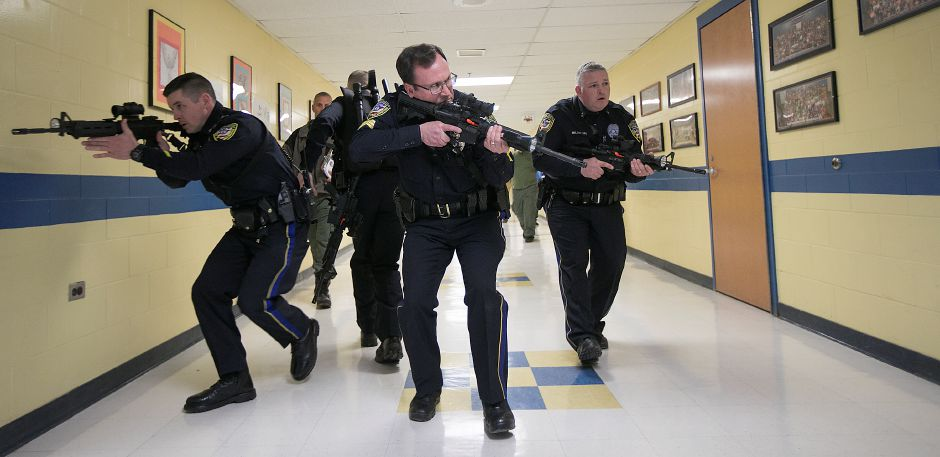 Wallingford Police, left to right, Ofc. Darren Frith, Sgt. David Blythe and Ofc. Dave Miller search the main hall during Active Shooter Training at Moran Middle School in Wallingford, Thursday, April 19, 2018. Dave Zajac, Record-Journal