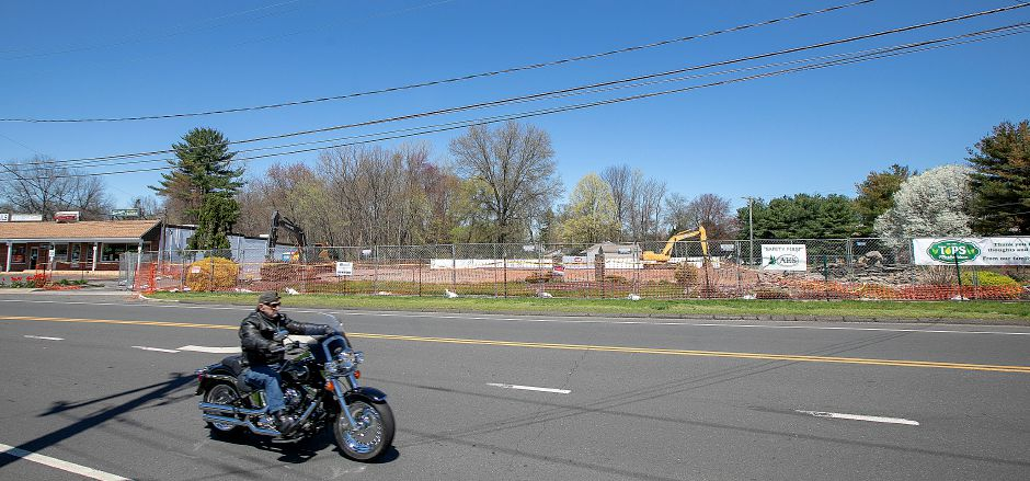A motorcyclist rides by the cleared site of the former Tops Market in Southington, Wed., Apr. 24, 2019. A fire destroyed the business on March 3rd. Dave Zajac, Record-Journal