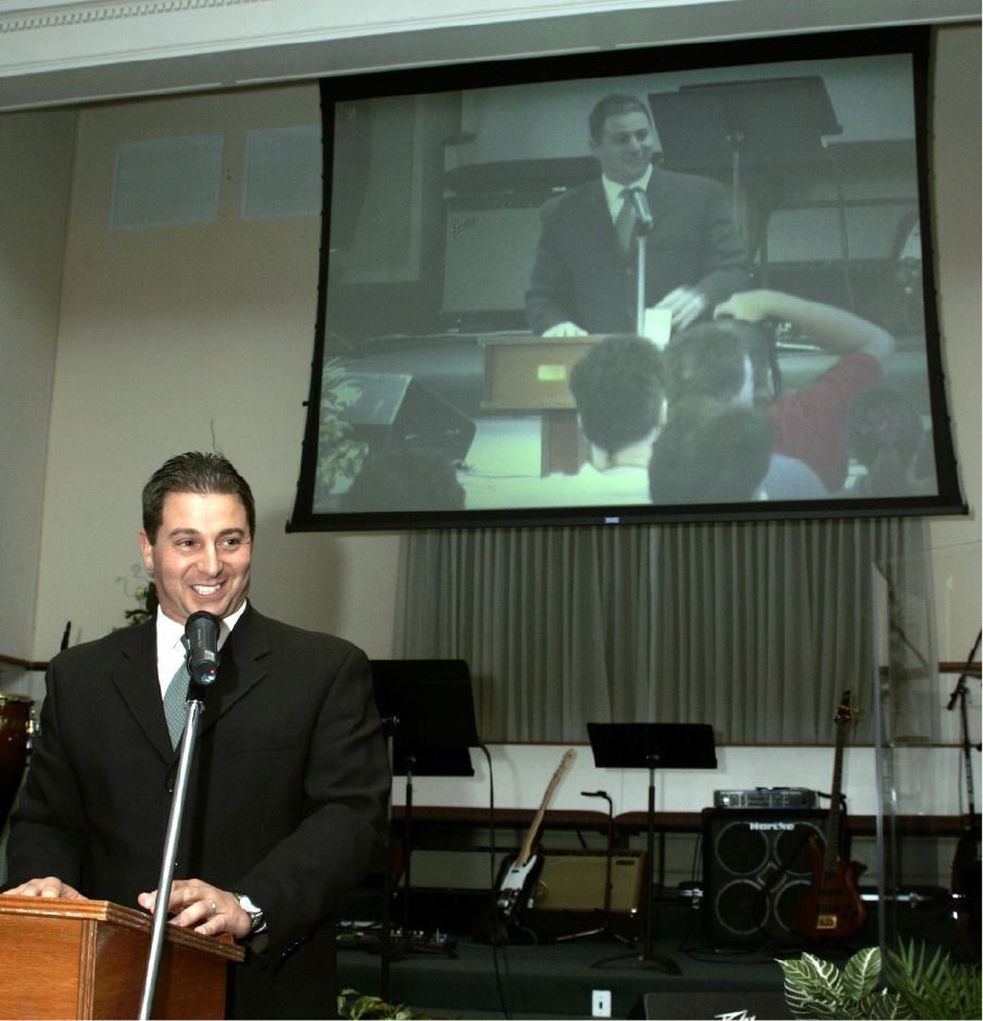 Mayor Mark Benigni addresses the overflow crowd at the New Life Church on Bee St. Mon. night, Sept. 11, 2006 for the 9/11 ceremony, complete with live video projection on the screen behind him.