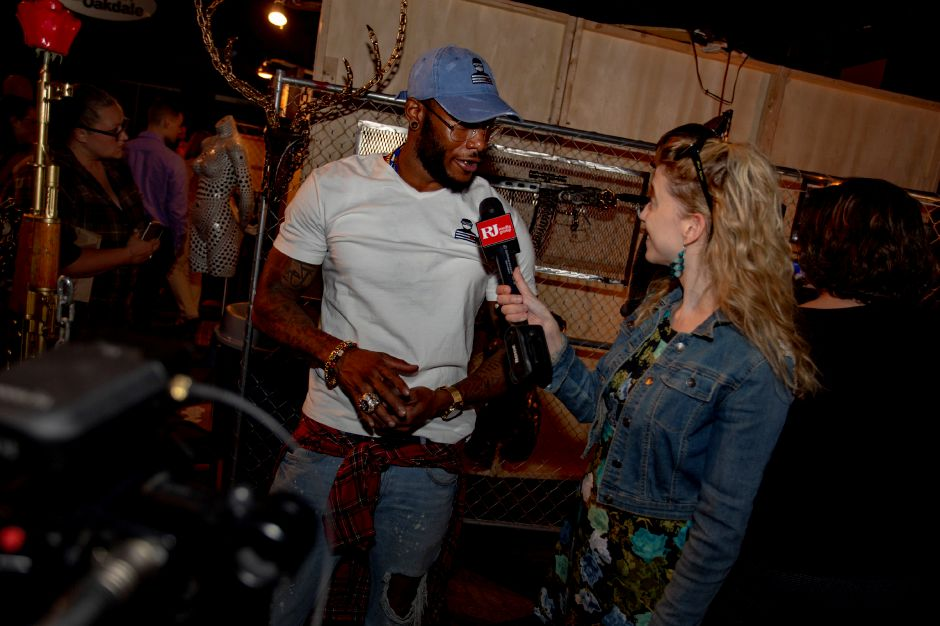 Steeling Roses artist Byron Troy talks with Record-Journal Digital Content Producer Ashley Kus about his artwork on display at the RAW Artist Connect showcase at the Oakdale Theatre July 18, 2018. | Richie Rathsack, Record-Journal