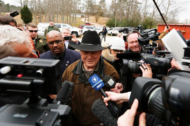 Republican U.S. Senate candidate Roy Moore talks to the media on election day as he votes, Tuesday, Dec. 12, 2017, in Gallant, Ala. (AP Photo/Brynn Anderson)