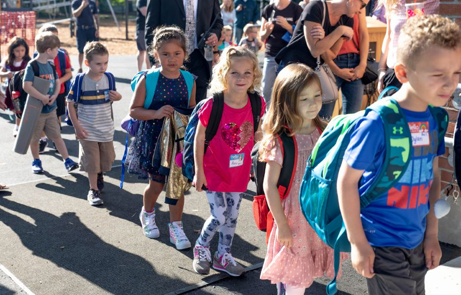 Students file into Wheeler Elementary School in Plainville on the first day of school on Sept. 3, 2019. | Devin Leith-Yessian/Plainville Citizen