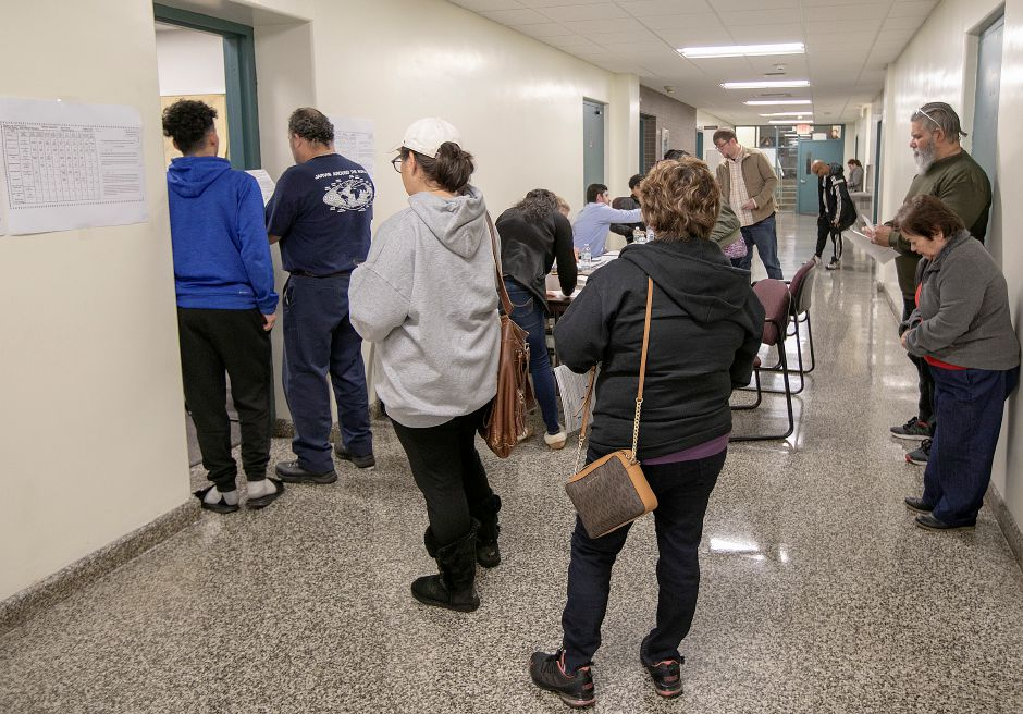 Voters form a line as they wait for Election Day registration at Meriden City Hall Tuesday afternoon, Nov. 6, 2018. Dave Zajac, Record-Journal