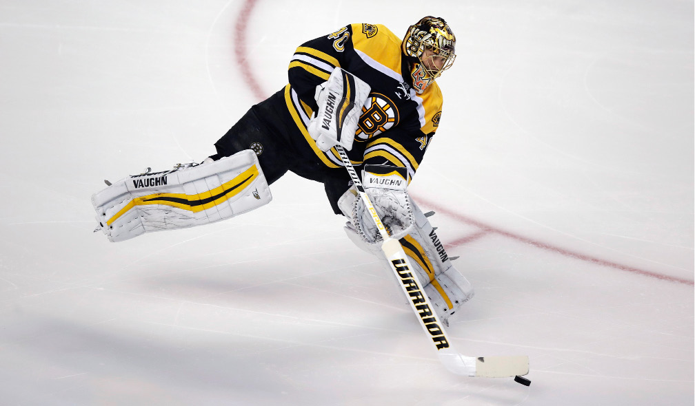 Boston Bruins goalie Tuukka Rask (40) clears the puck after a save during the first period of an NHL hockey game against the Florida Panthers in Boston, Monday, Dec. 5, 2016. (AP Photo/Charles Krupa)