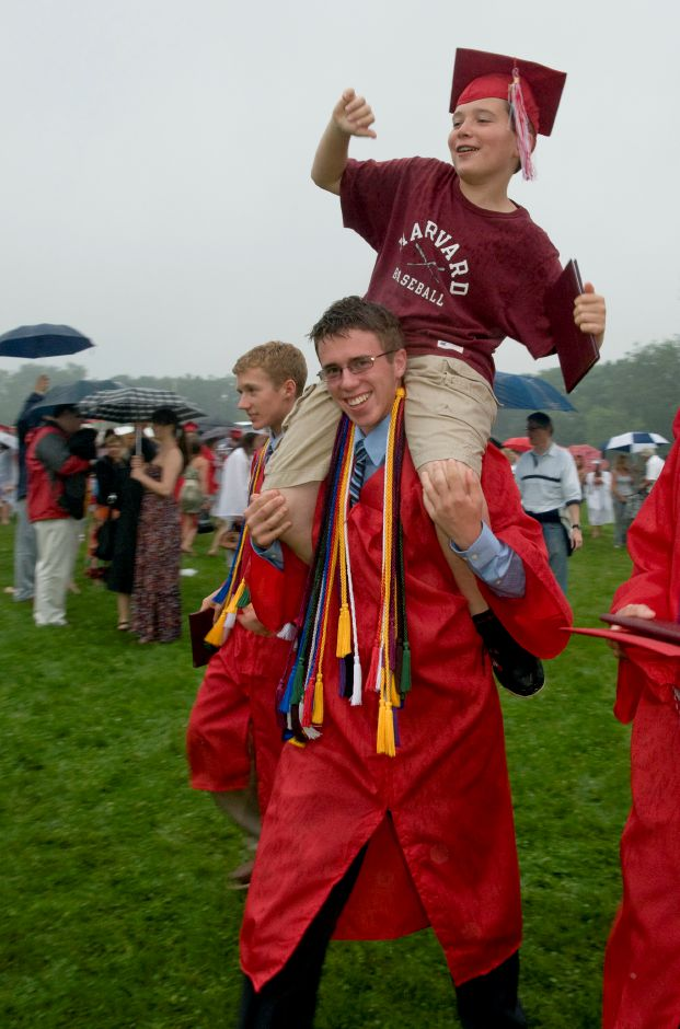 Cheshire graduate Sean Kinyon, 18, carries his younger brother, Spencer, 11, on his shoulders after graduation, June 22, 2011. (Sarah Nathan/Record-Journal)
