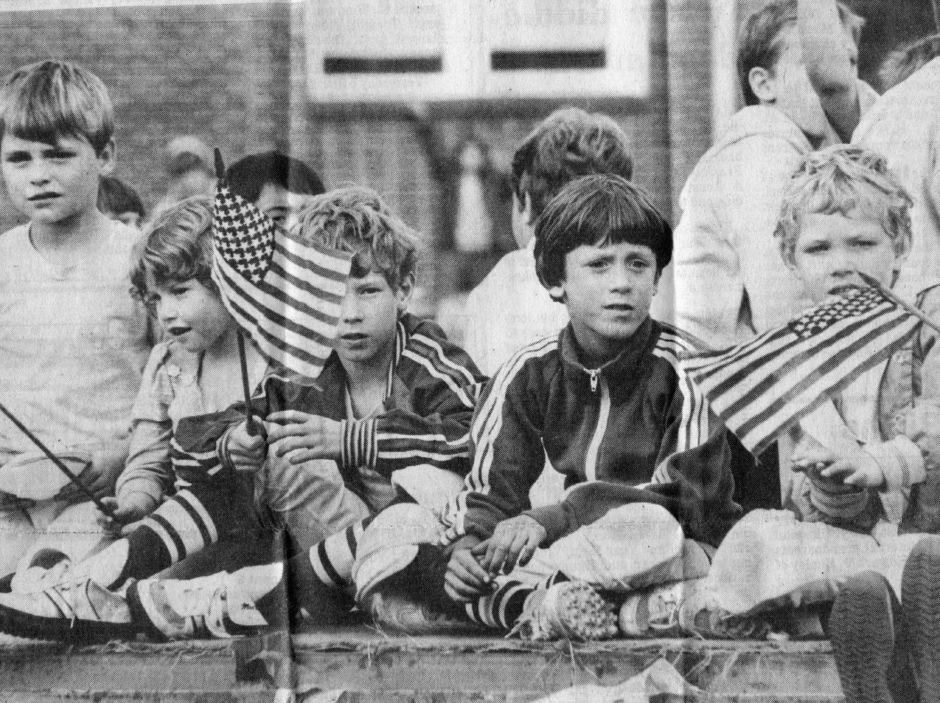 Kids watch the 1985 Apple Harvest Festival parade in Southington. | (Record-Journal file)