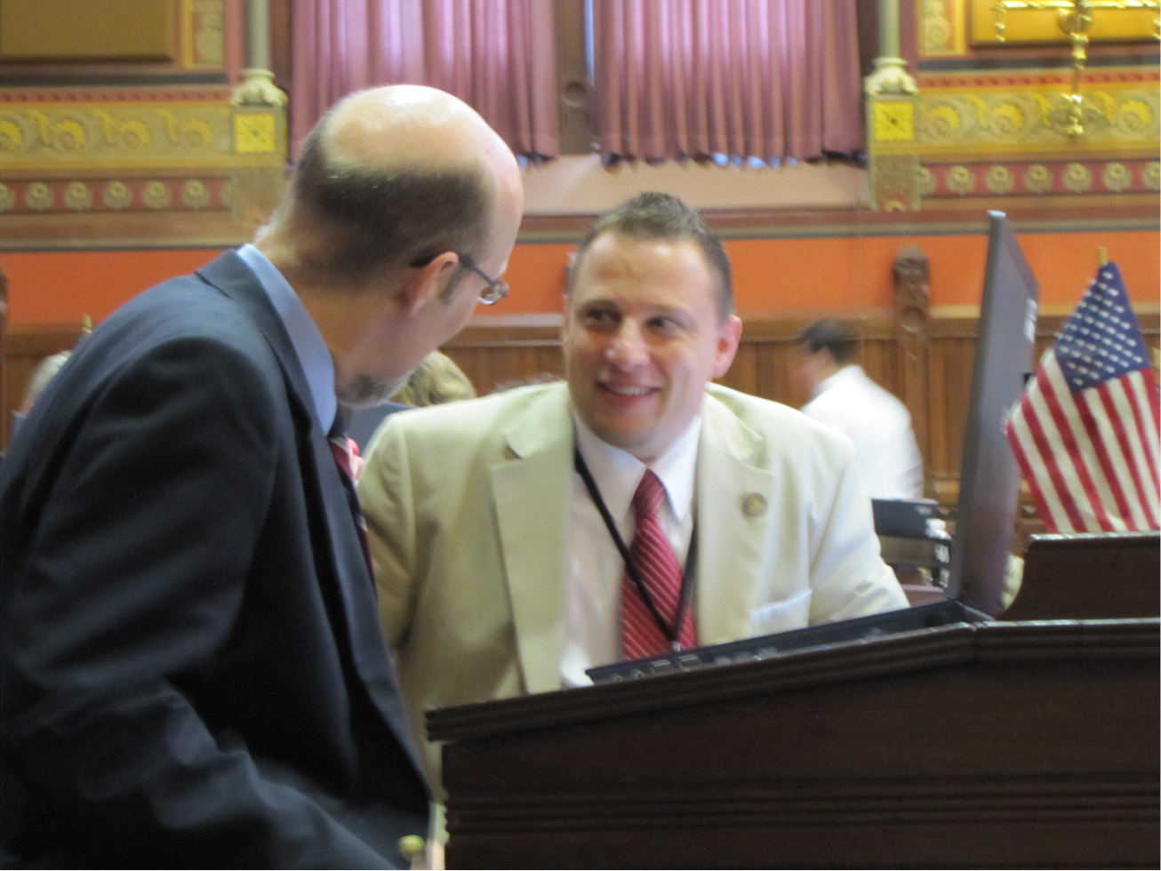 FILE PHOTO: Rep. Rob Sampson, R-Wolcott, right, consults with Sen. Joe Markley, R-Southington, during a House debate, | Arielle Levin Becker / The Connecticut Mirror