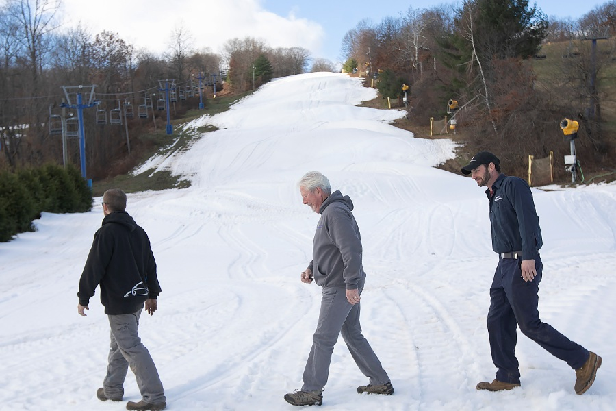 Left to right, Shane Riley, snow-making supervisor, Duane Bass, general manager and Josh Wilensky, lift mechanic, walk across one of the snow covered trails at Mount Southington, Thurs., Nov. 29, 2018. Dave Zajac, Record-Journal