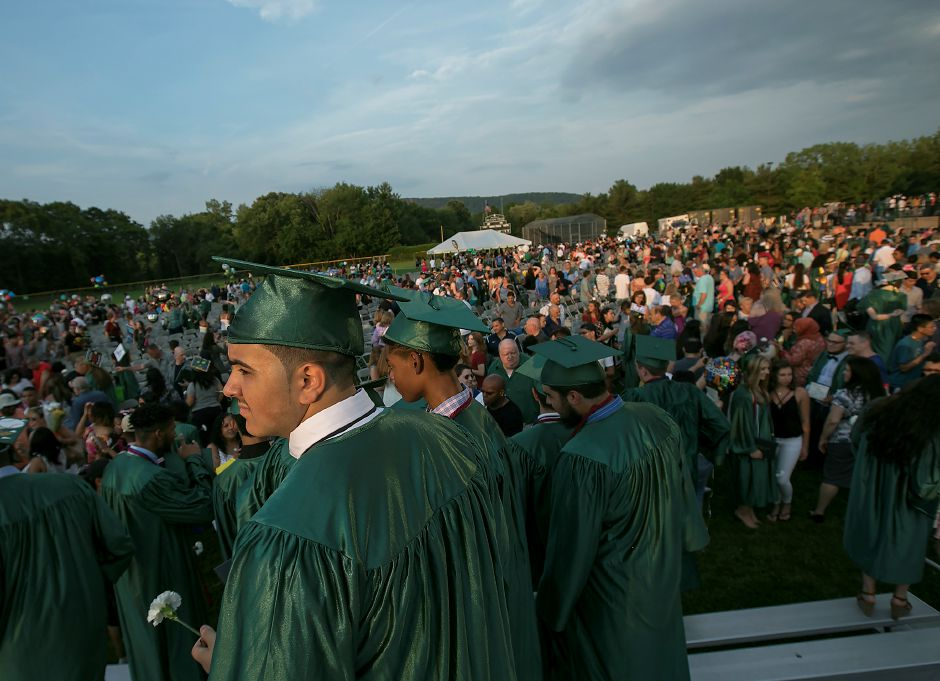 The sun sets on graduates at conclusion of graduation ceremonies at Maloney High School in Meriden, Tuesday, June 13, 2017. | Dave Zajac, Record-Journal