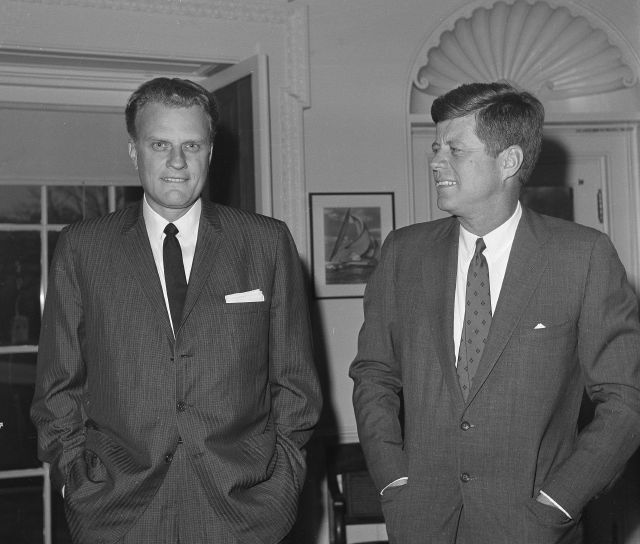 Graham, left, talks with President John F. Kennedy during a 1961 visit to the the White House in Washington. Associated Press