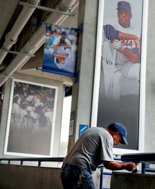 Maintenance worker Bill Sloan paints railings inside First Data Field, spring training home of the New York Mets, ahead of the official start of spring training baseball practice Tuesday, Feb. 13, 2018, in Port St. Lucie, Fla. (AP Photo/Jeff Roberson)