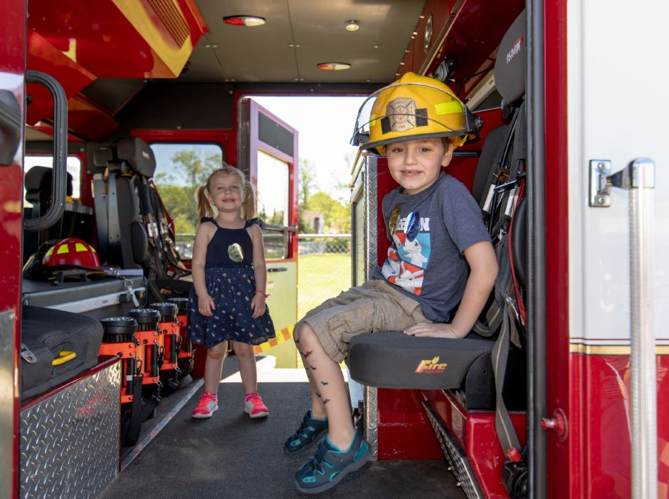 Samuel Deschaine, 3, and Hannah Procko, 3, of Plainville, play in the cabin of Plainville Fire Department Rescue One during the Family Fest on May 11. | Devin Leith-Yessian, The Citizen