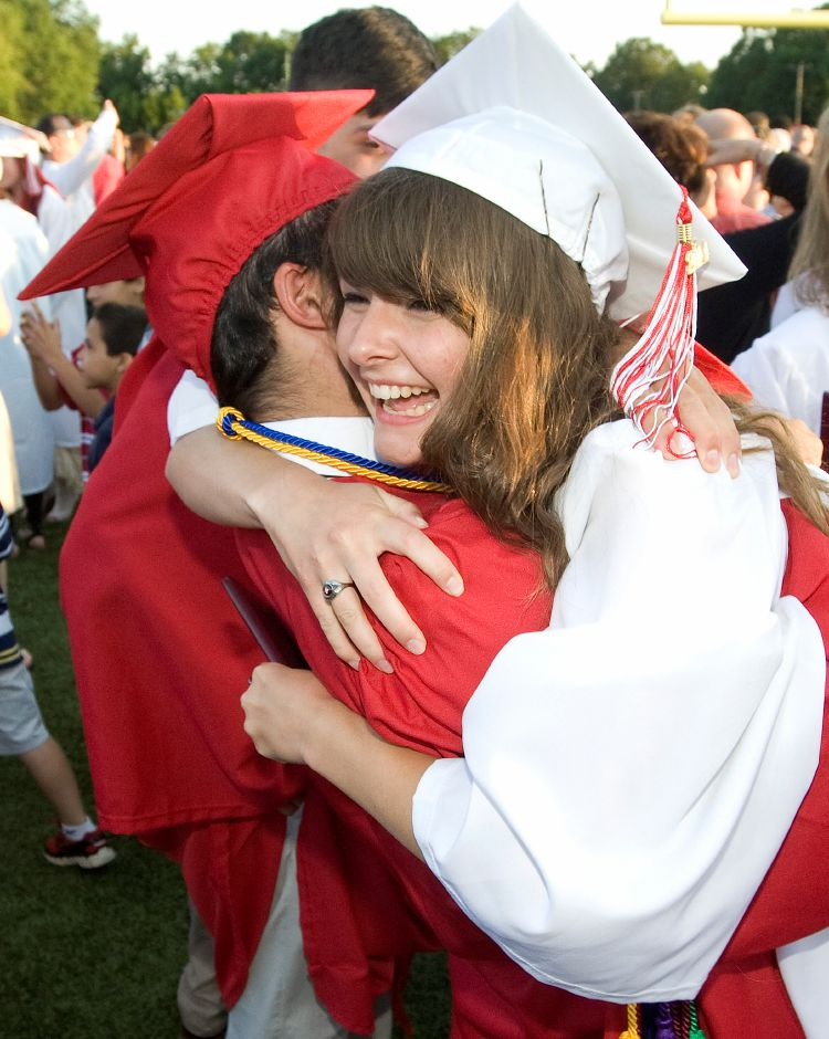 Graduates Phoebe Carmichael and friend Michael Milici, Jr. embrace at conclusion of commencement ceremonies at Cheshire High School, Tuesday, June 24, 2014. | Dave Zajac / Record-Journal