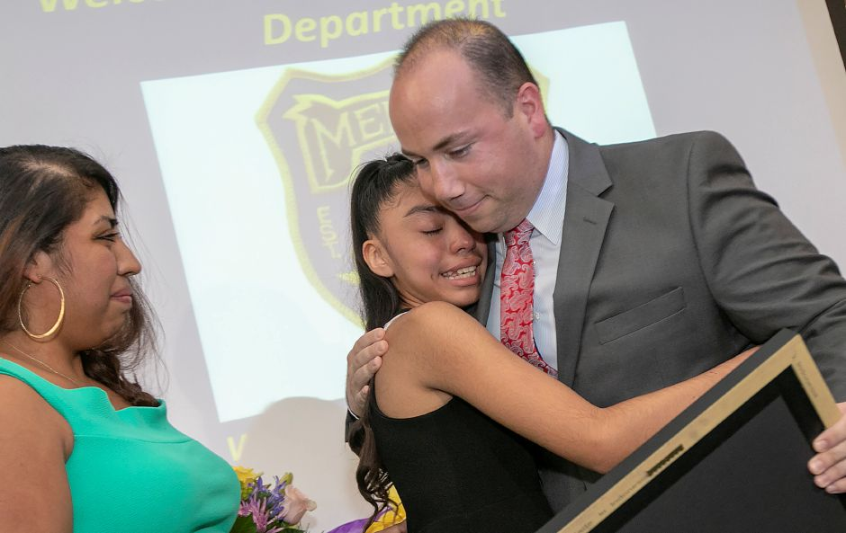 Leslie Meza Ruiz, 12, of Meriden, is hugged by Mayor Kevin Scarpati during a ceremony honoring her at the Meriden Police Department, Friday, August 24, 2018. Leslie was recognized for her brave and courageous acts demonstrated during an armed robbery. Mayor Scarpati presented her a proclamation from the Office of the Mayor declaring August 27th 2018 Leslie Meza Ruiz Day. Yesenia Ruiz, Leslie