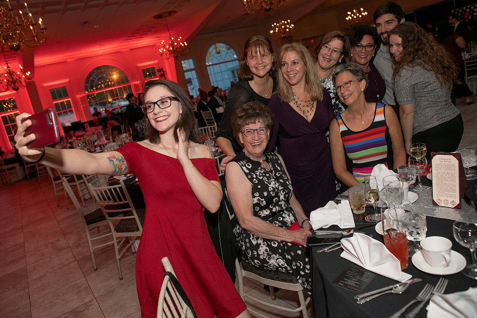 Kelsey Brown, a cook for Dad's Restaurant in Wallingford, snaps a photo of the restaurant's staff  at the Record-Journal Readers' Choice Awards at the Aqua Turf Club in Southington on Wednesday. See more photos on A5. Today's Record-Journal also includes a special section on the 2018 Readers' Choice Awards. Look for more photos and video of the event online at Myrecordjournal.com and more coverage in upcoming editions of the Record-Journal.    Dave Zajac, Record-Journal