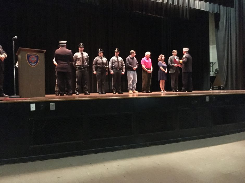 Community members and Southington Police officers accept citizen commendations at the Southington Fire Department's annual awards ceremony at Derynoski Elementary School on Oct. 11, 2017. | Lauren Takores, Record-Journal
