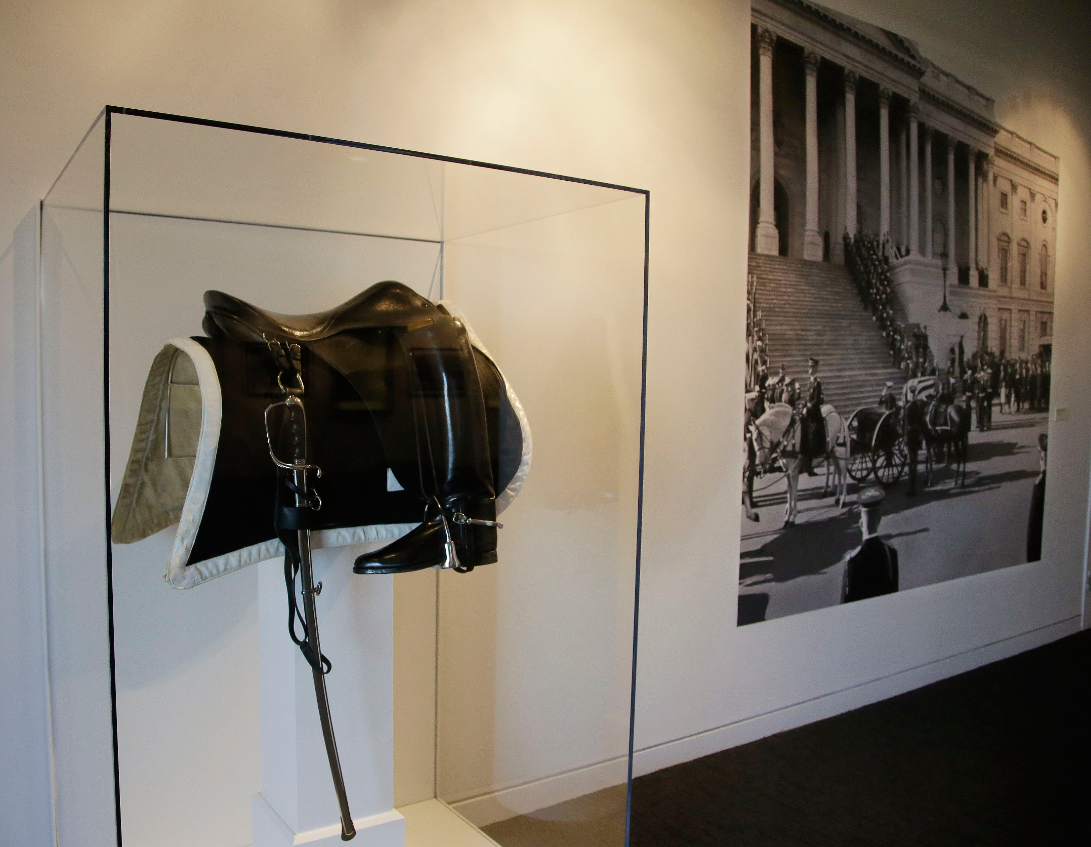 A small new exhibit at the John F. Kennedy Library and Museum marking the 50th anniversary of the assignation of the 35th President of the United States includes never-before-displayed artifacts from his three-day state funeral, such as the saddle, boots and sword which sat atop the riderless horse in Kennedy