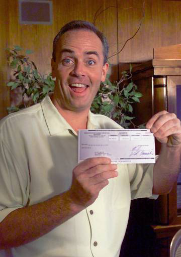 "Richard Hatch, winning castaway of the CBS television hit show ""Survivor,"" reacts as he holds his prize, a $1 million dollar check, Friday, Aug. 25, 2000, at the CBS Television studios in Los Angeles. When Hatch was selected by his fellow ``Survivor"