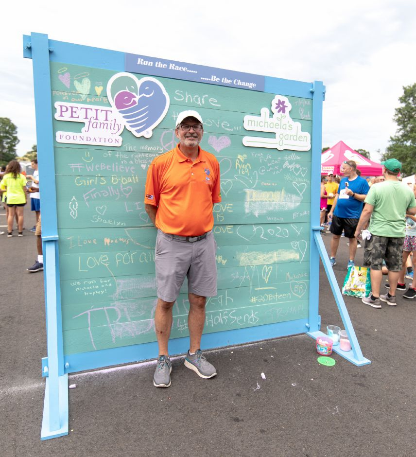 William Petit Jr. stands in front of a wall at the Chips Family Restaurant Road Race on July 21, 2019 in Plainville. The run is one of the two largest fundraisers for the Petit Family Foundation, which gives out scholarships for local high school graduates and grants for nonprofits. | Devin Leith-Yessian/Plainville Citizen