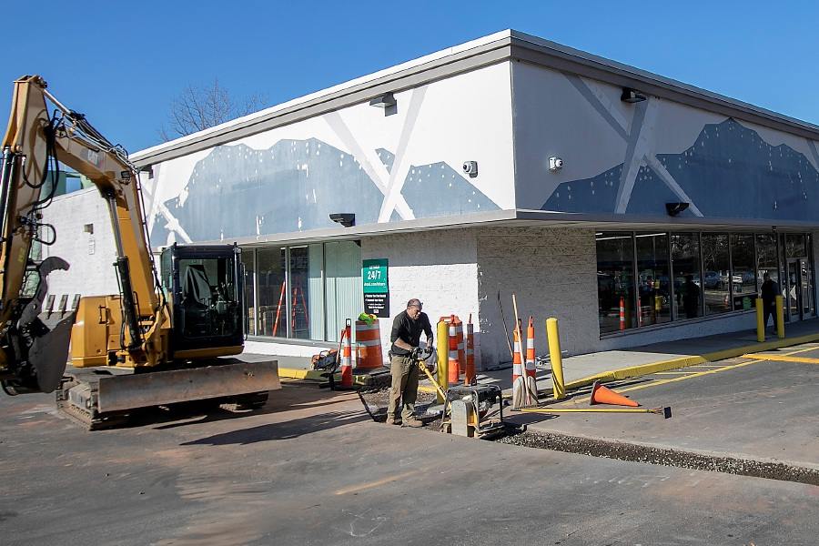 A worker operates a compactor in preparation for resurfacing as work continues in front of the new U-Haul at Lincoln Plaza, 311 W. Main St, Meriden, Fri., Nov. 15, 2019. U-Haul opened a 5,000 square-foot retail and rental store in Lincoln Plaza and will add 200 self-storage units in empty store fronts in the rear. Dave Zajac, Record-Journal
