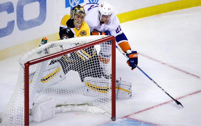 New York Islanders left wing Anders Lee, rear, catches Boston Bruins goalie Tuukka Rask (40) out of position as he sets to score during the first period of an NHL hockey game in Boston, Tuesday, Dec. 20, 2016. (AP Photo/Charles Krupa)