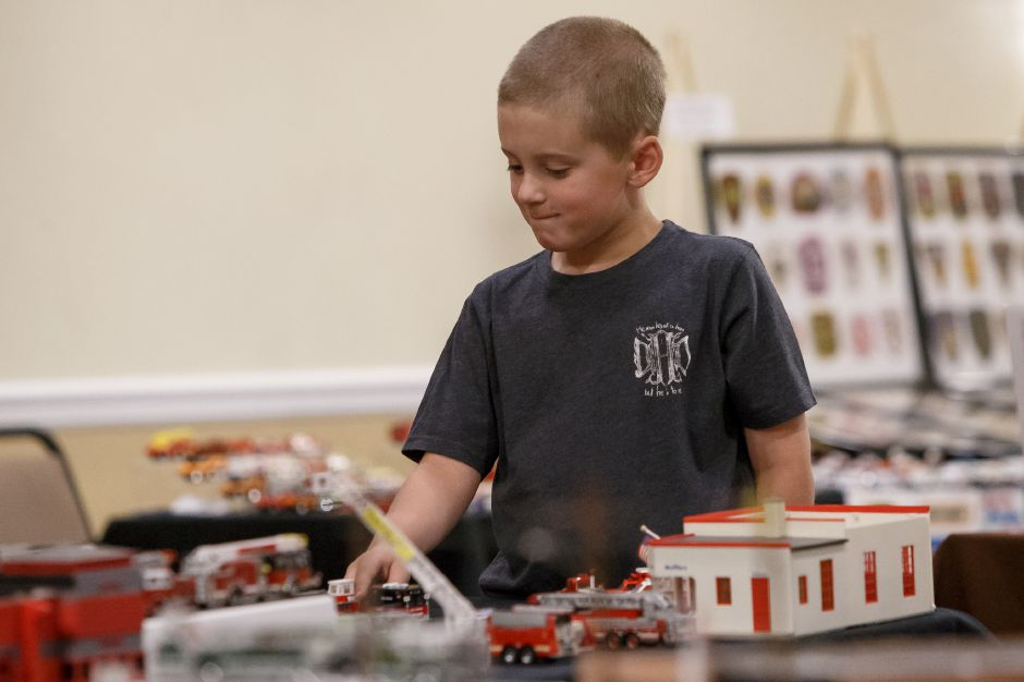 Steve Jason of Roxbury New Jersey sets up his model fire truck collection Saturday during the 9th Annual Silver City Fire Fest at Comfort Inn and Suites in Meriden July 21, 2018 | Justin Weekes / Special to the Record-Journal