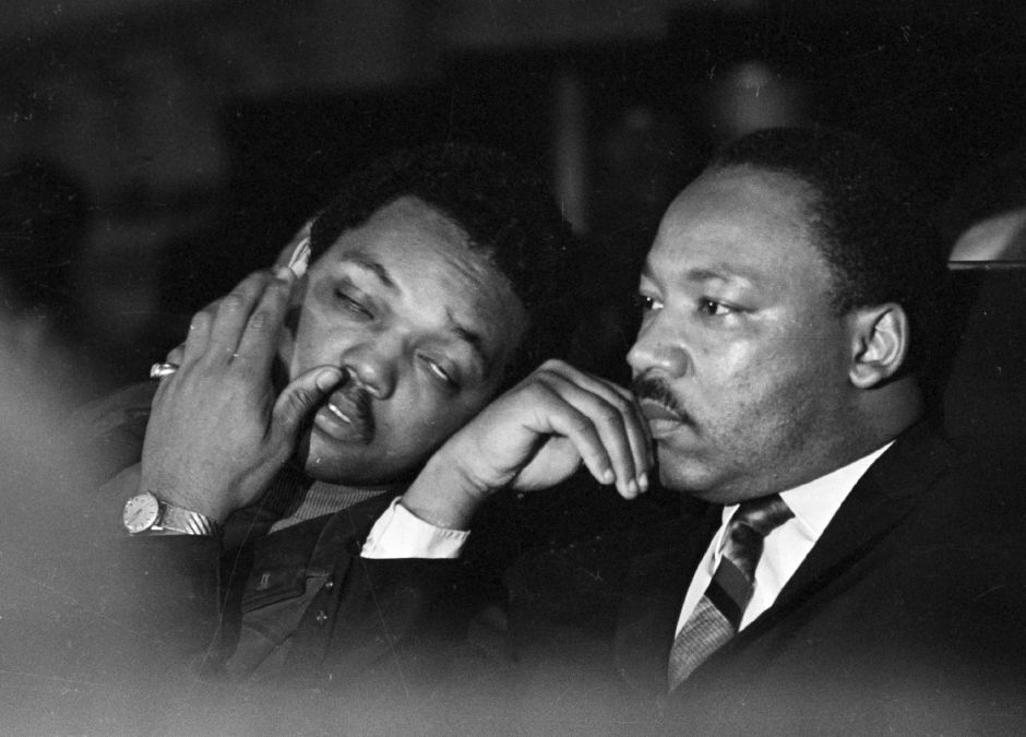 Dr. Martin Luther King, Jr. is seen here with Rev. Jesse Jackson, left, just prior to his final public appearance to address striking Memphis sanitation workers on April 4, 1968. King was assassinated later that day outside his motel room. (AP Photo/Charles Kelly)